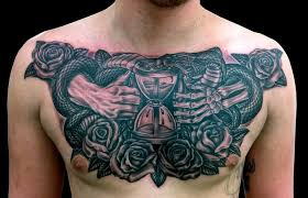 beautiful chest decorated with outstanding clock tattoo for men