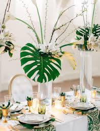 modern art deco wedding inspiration leaves centerpieces and palm
