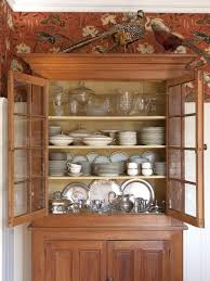 photos hgtv traditional wood china cabinet floral and aviary photos hgtv traditional wood china cabinet floral and aviary patterned wall treatment ikea dining room