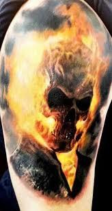 burning firefighter skull on back shoulder in 2017