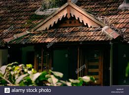 shed style architecture slanted roof of a cootage built in kerala style architecture stock