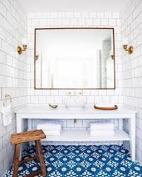 white and blue bathroom 10 tricks to steal from hotel bathrooms white tiles grout and