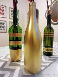 diy spray painted wine bottles for fall decorating painted wine