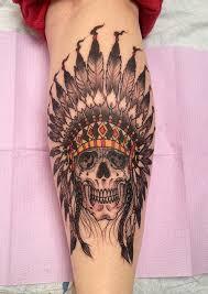 indian headdress tattoo on ribs native american skull and headdress tattoo by jeff johnson tattoos