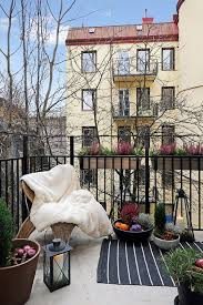 small apartment balcony with pretty decorations and lantern lights
