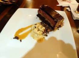 german chocolate cake with caramel sauce and heath bar ice cream