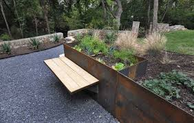 Garden Bench With Planters 9 Ideas For Including Weathering Steel Planters In Your Garden