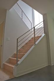 modern neutral wooden staircase with minimalist steel railing