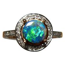 black opal engagement rings black opal ring halo design flashopal