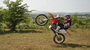 motocross biking learning to wheelie a dirt bike honda crf250r youtube