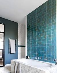 marble and monochrome bathroom with blue feature walls bathroom