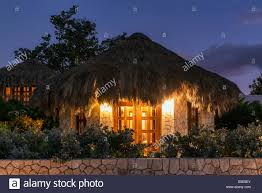 boutique hotel cottages with thatched roof at night negril