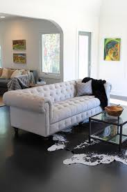 Chesterfield Sofa Los Angeles Cowhide Rug And Linen Chesterfield Sofa Eclectic Living Room