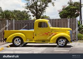 Vintage Ford Truck Colors - small pickup truck bright yellow color stock photo 13621030
