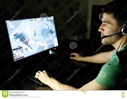 man playing video game in dark room stock photo image 73681594
