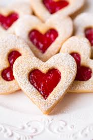 heart shaped cookies linzer cookies with strawberry and raspberry jam