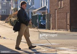 Blind Man Cane Closeup Of Blind Man Walking With White Cane Stock Photo Getty