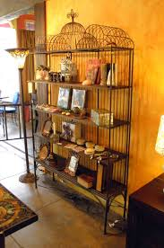 dark brown steel bookcase with five shelves combined with bars on