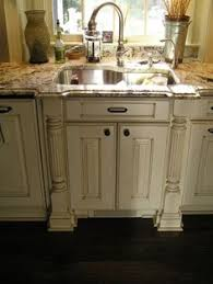 How To Distress Kitchen Cabinets by Glaze Over White Cabinets Tea Stain Glaze Over Cream Paint Me