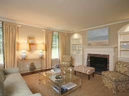 elegant transitional living rooms fancy chandelier black leather