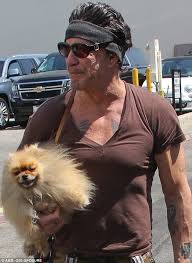 rambo headband mickey rourke is joined by pooch as he dines out in beverly