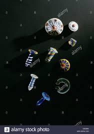 a selection of ear ornaments glass papyrus column pendants