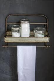 vintage on the shelf farmhouse metal shelf and towel rack