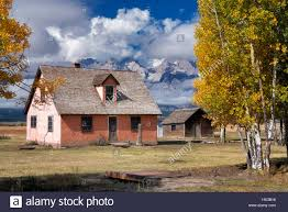 pink house at john moulton homestead with teton mountains and