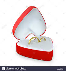 wedding ring in a box pair of wedding rings in a heart shaped box stock photo royalty