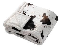 pouf en peau de vache plaid microfibre effet peau de vache marron blanc revers mouton