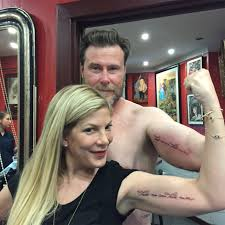 tori spelling and dean mcdermott get matching tattoos for 10th