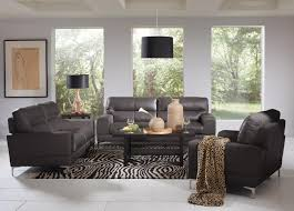 Gray Leather Sofa And Loveseat Grey Leather Sofa And Black Wooden Table With Zebra Pattern Rug On