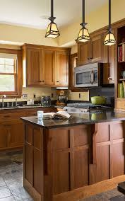 singer kitchen cabinets cherry kitchen cabinets with gray wall and quartz countertops