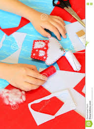 child making christmas crafts child put his hands on a table