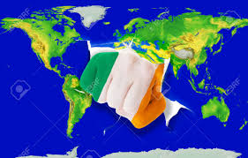 fist in color national flag of ireland punching world map as