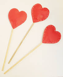 stick paper stuffed paper hearts on a stick for fun summer centerpieces