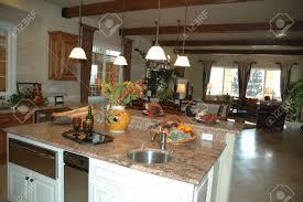 modern living room setting and modern kitchen in new development
