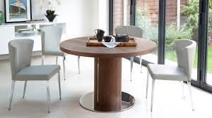 round wooden extending dining table and modern chairs youtube
