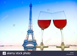 French Flag Eiffel Tower Two Wine Glasses Lean Toward Each Other On Glass Table With The