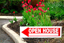 real estate open house directional sign with pointing arrow in