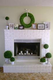 decor diy projects with white brick fireplace and garlant on the
