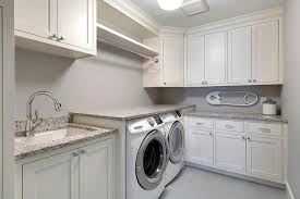 White Cabinets For Laundry Room White Shaker Laundry Room Cabinets With Gray Granite Countertops