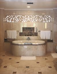 interesting bathroom presenting beige ceramics bathtub and mocha