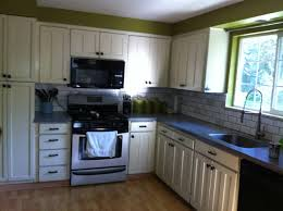 white kitchen cabinets to a hand painted stained wood look and