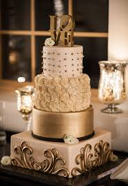 romantic gold wedding cake display on wedding reception