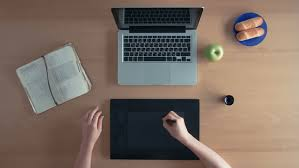 typing on a laptop on a busy desk top view ms stock footage