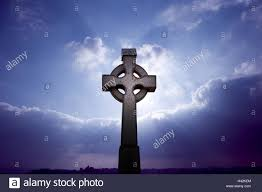 cemetery cross celtic cloudy sky backlight sunrays