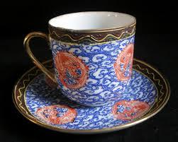 porcelain demitasse cup and saucer japanese dragon design