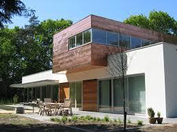 house aluminum frames white stucco wooden terrace pond woning