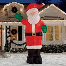 Outdoor Christmas Decorations Dinosaur by Amazon Com Christmas Inflatable Giant 12 U0027 Waving Santa By Gemmy